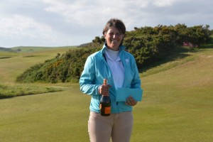 Glenda with her Hole In One Bubbly!